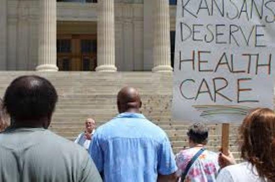 Protestors demanded action on a Senate bill that would provide health coverage for an additional 150,000 low-income Kansans. (Photo: Kansas Health Institute)