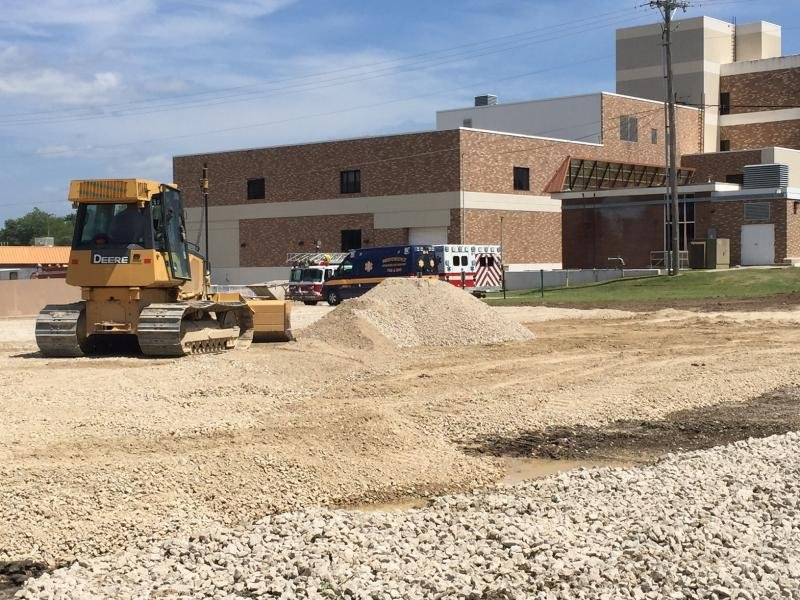 Since Mercy Hospital in Independence, Kansas closed in fall 2015, a large portion of the building has been torn down. A garage for city emergency vehicles is being built in its place. (Photo by Jim McLean, KHI News Service)