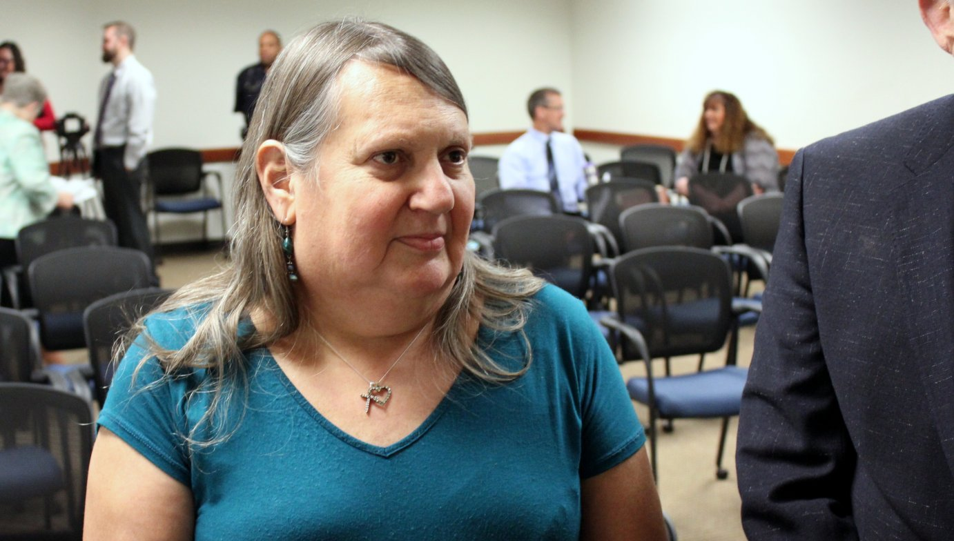 Stephanie Mott meeting with reporters after the meeting. (Photo by Stephen Koranda)
