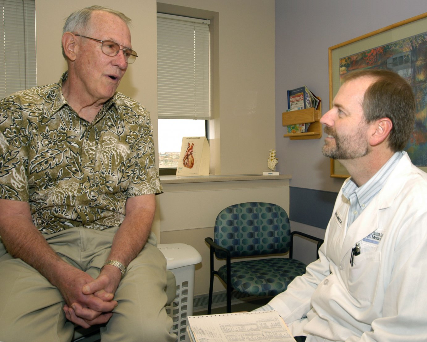 Michael Munger, MD, consults with a patient at his office in Overland Park (photo courtesy AAFP)