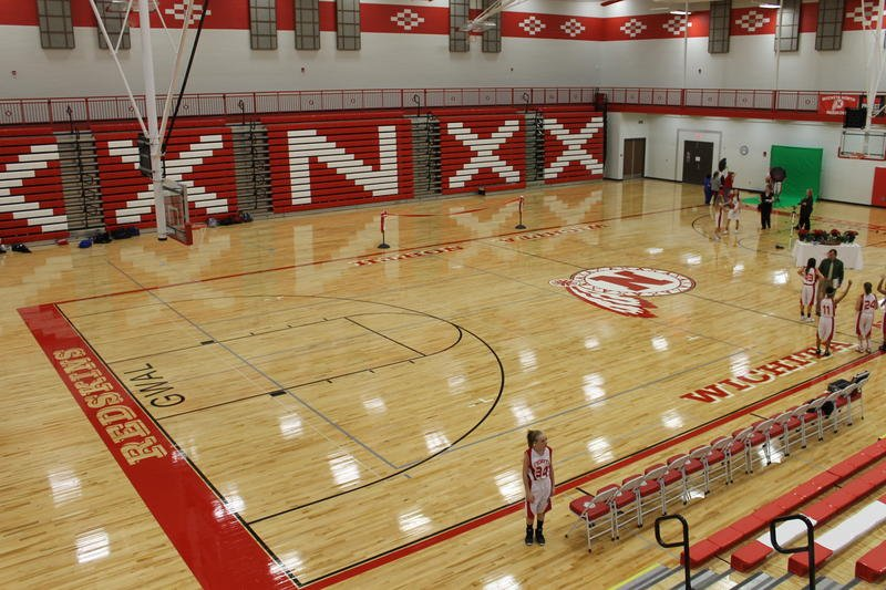 """The word """"Redskins"""" on Wichita North High School's basketball court will be painted over after the Wichita district dropped the controversial name. (Photo by Suzanne Perez, KMUW)"""