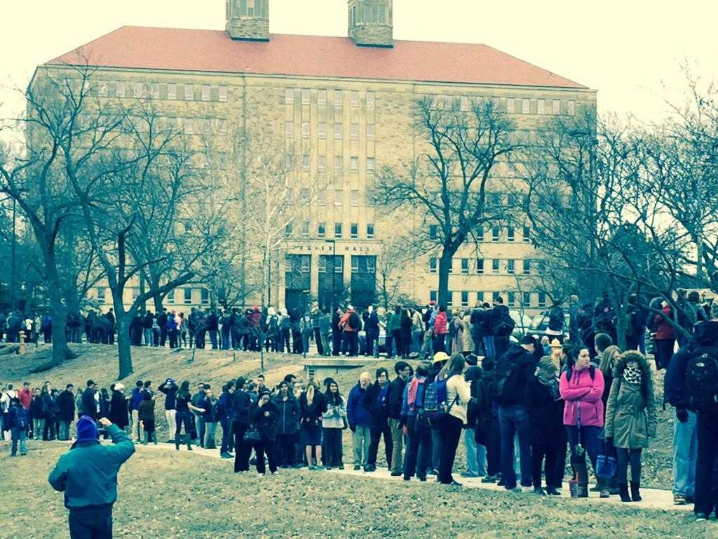 View of campus line for tickets to President Obama's Thursday speech. In this shot, the line extends up Jayhawk Boulevard in front of Fraser Hall and Watson Library (photo courtesy of Richard Noggle)