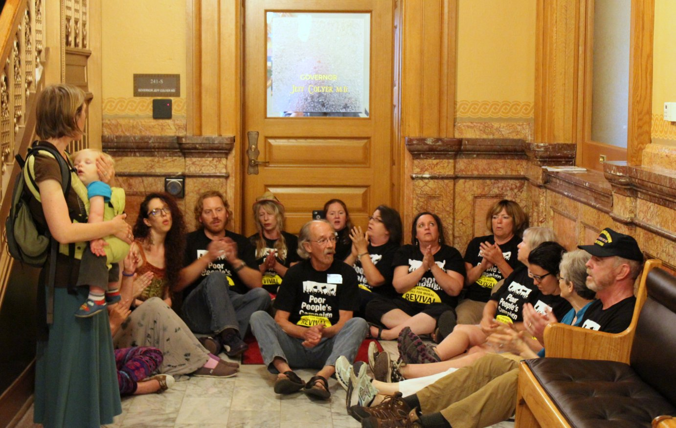 Protesters in the Kansas Capitol this week. (Photo by Stephen Koranda)