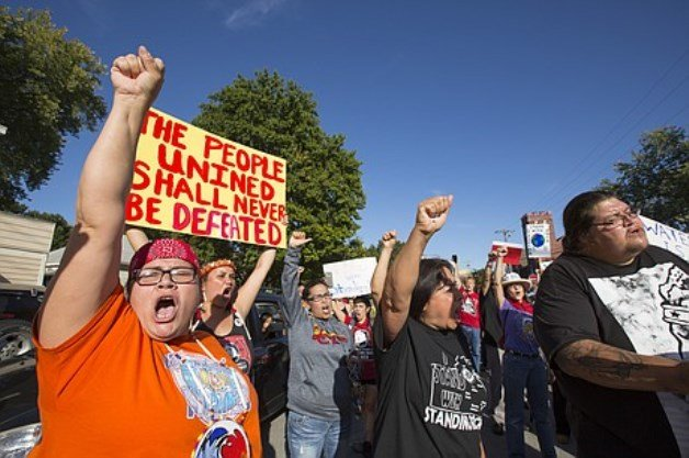 Several hundred protesters marched in downtown Lawrence in support of the Standing Rock Sioux Tribe in North Dakota. (Photo by Nick Krug, Lawrence Journal World)