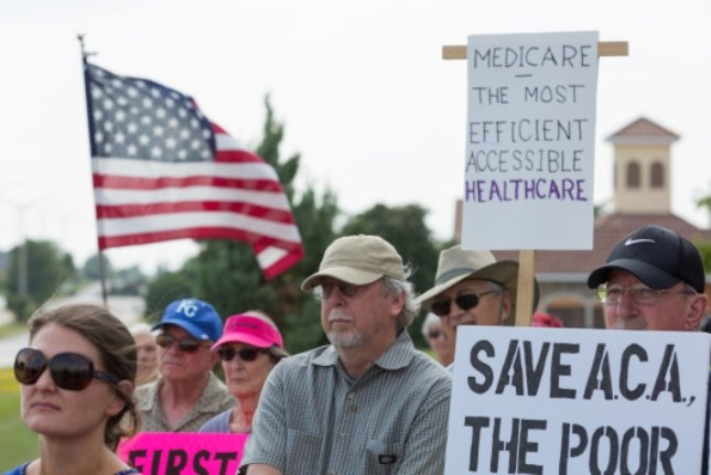 Several Kansas City-area activist groups organized a demonstration outside Senator Moran's district office in Olathe to protest the Republican health care bill.