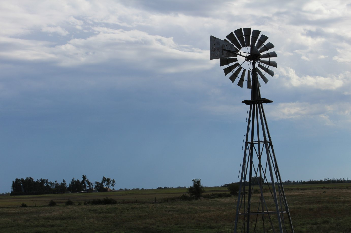 Traditional windmills, like this one near Quivira National Wildlife Refuge in Stafford County, still dot the Kansas landscape and continue to be seen in many other parts of rural America. (Photo by J. Schafer)