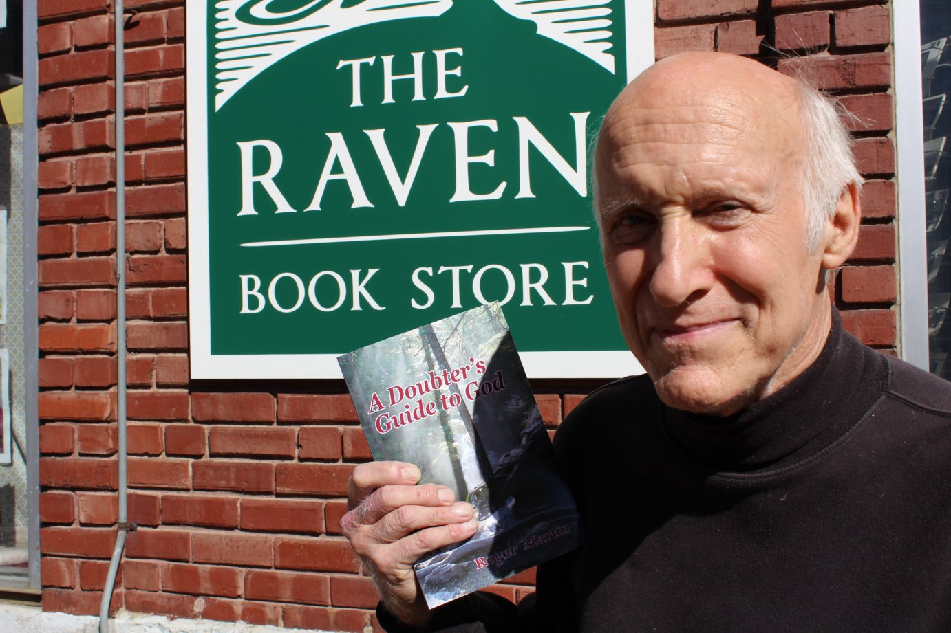 Lawrence writer Roger Martin, sitting outside the Raven Book store in downtown Lawrence. (Photo by J. Schafer)
