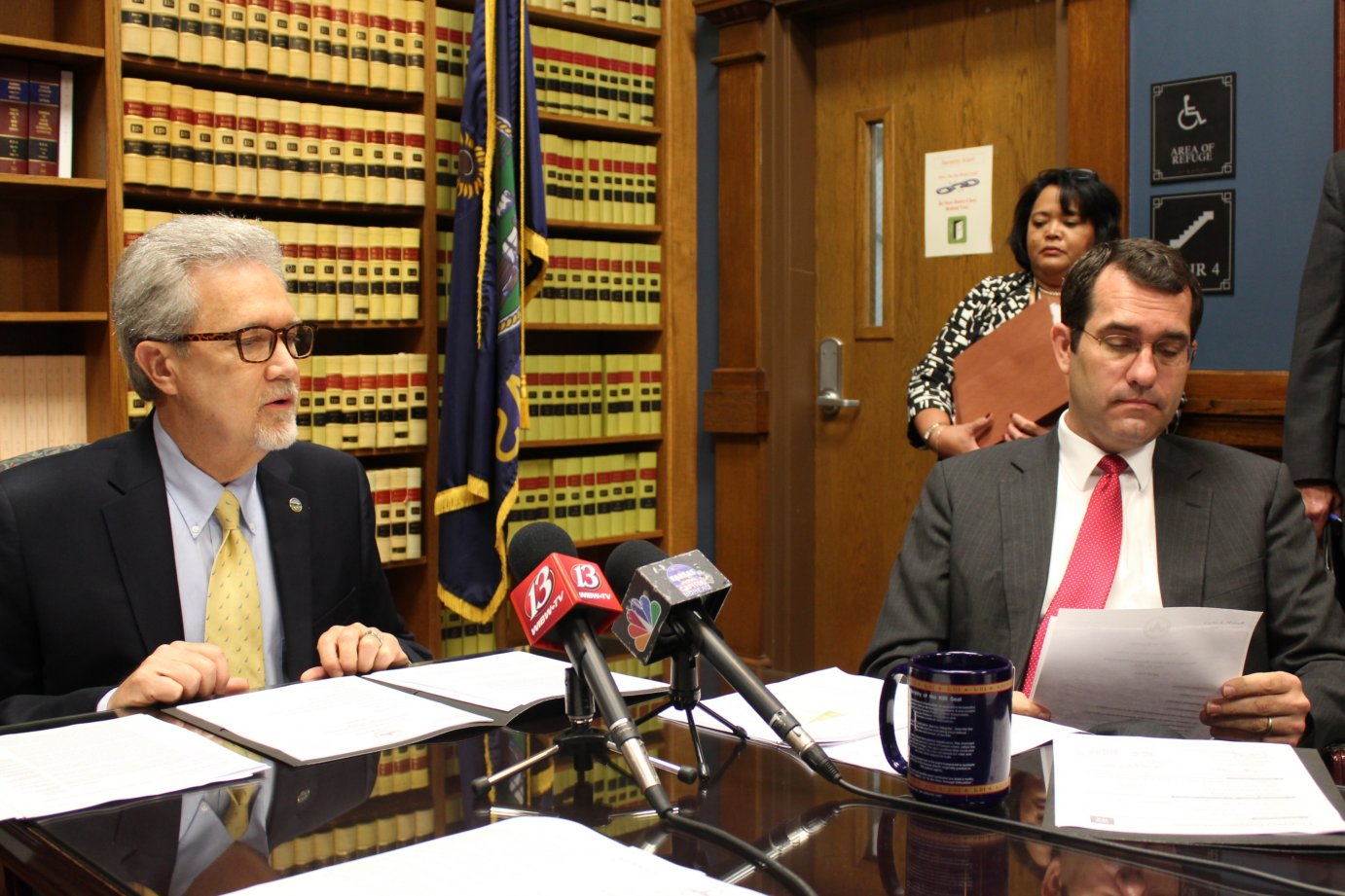 Assistant Secretary of State Eric Rucker (left) and Attorney General Derek Schmidt during the meeting Tuesday. (Photo by Stephen Koranda)