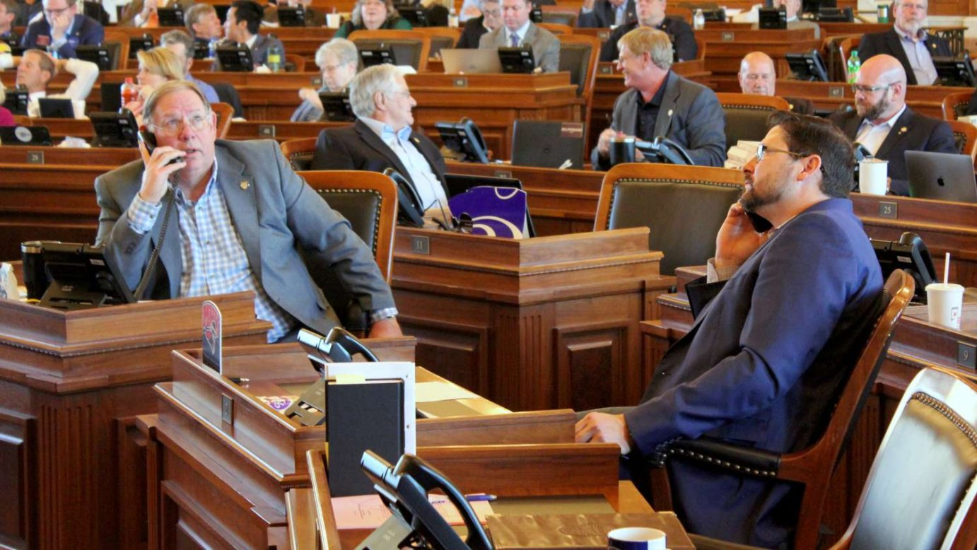 Republican Majority Leader Rep. Dan Hawkins (left) and Kansas House Speaker Ron Ryckman worked the phones to secure enough votes to end a standoff over Medicaid expansion and pass the budget to end the legislative session. (Photo by Stephen Koranda)