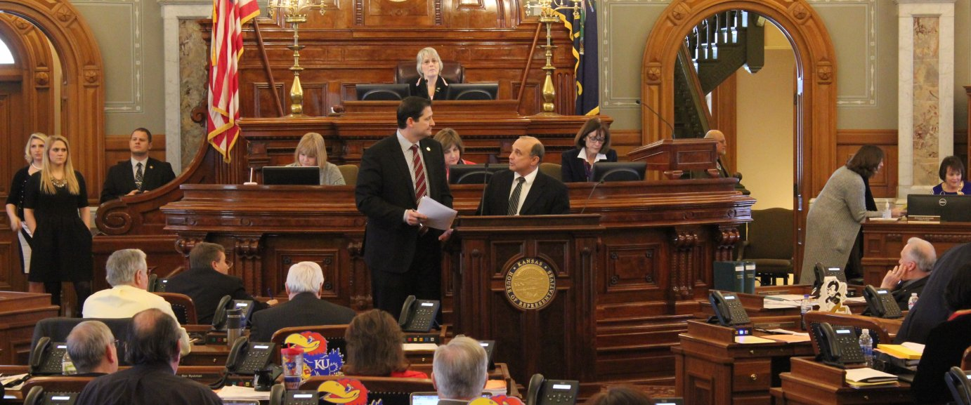 Republican Ron Ryckman (left) and Democrat Jerry Henry discuss the bill during the House debate. (Photo by Stephen Koranda)