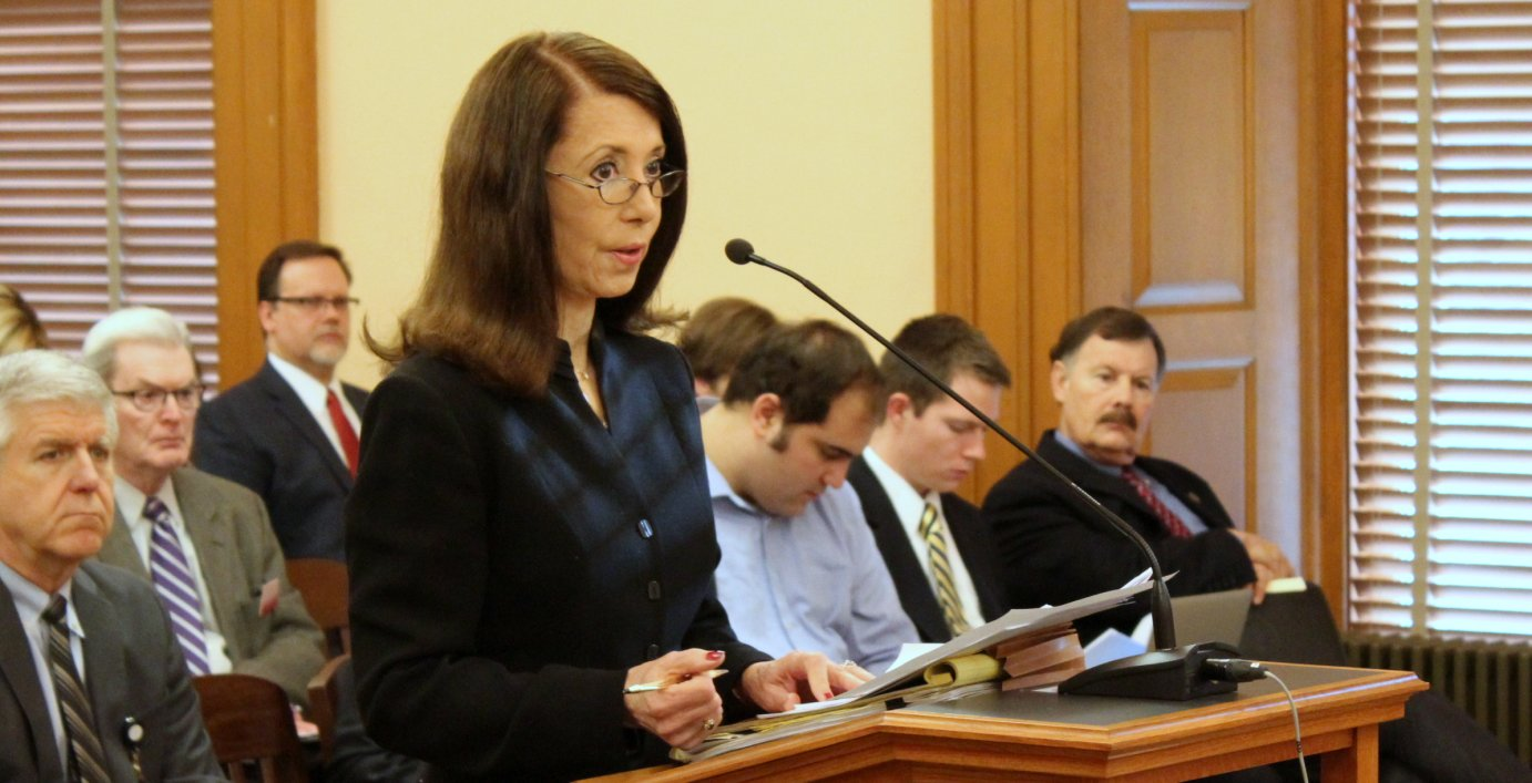 Patricia Scalia asking a legislative committee to increase funding for defense services. (Photo by Stephen Koranda)