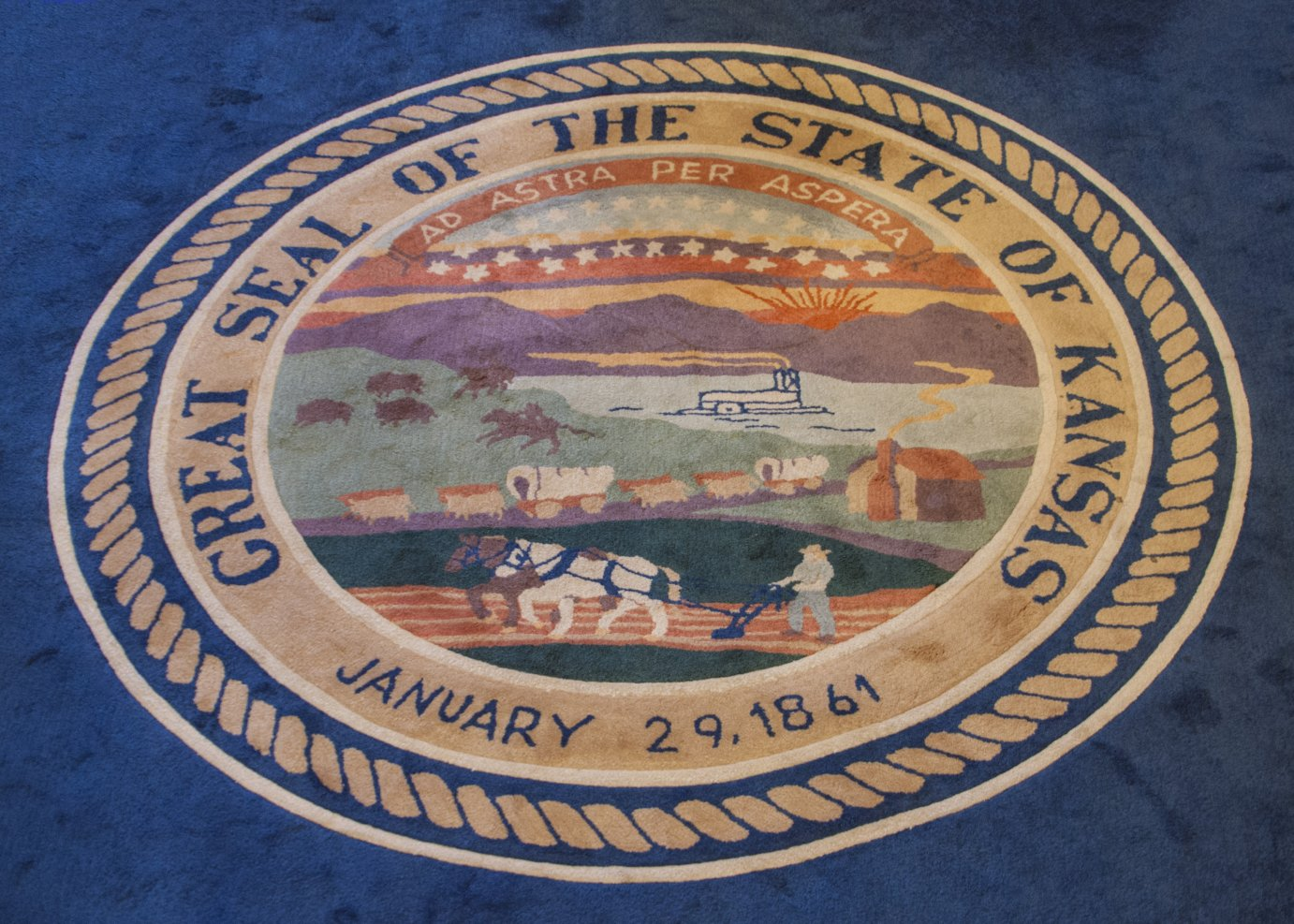 Ornamental rug, depicting state seal, in the Kansas governor's ceremonial office. (Photo by Dan Skinner)