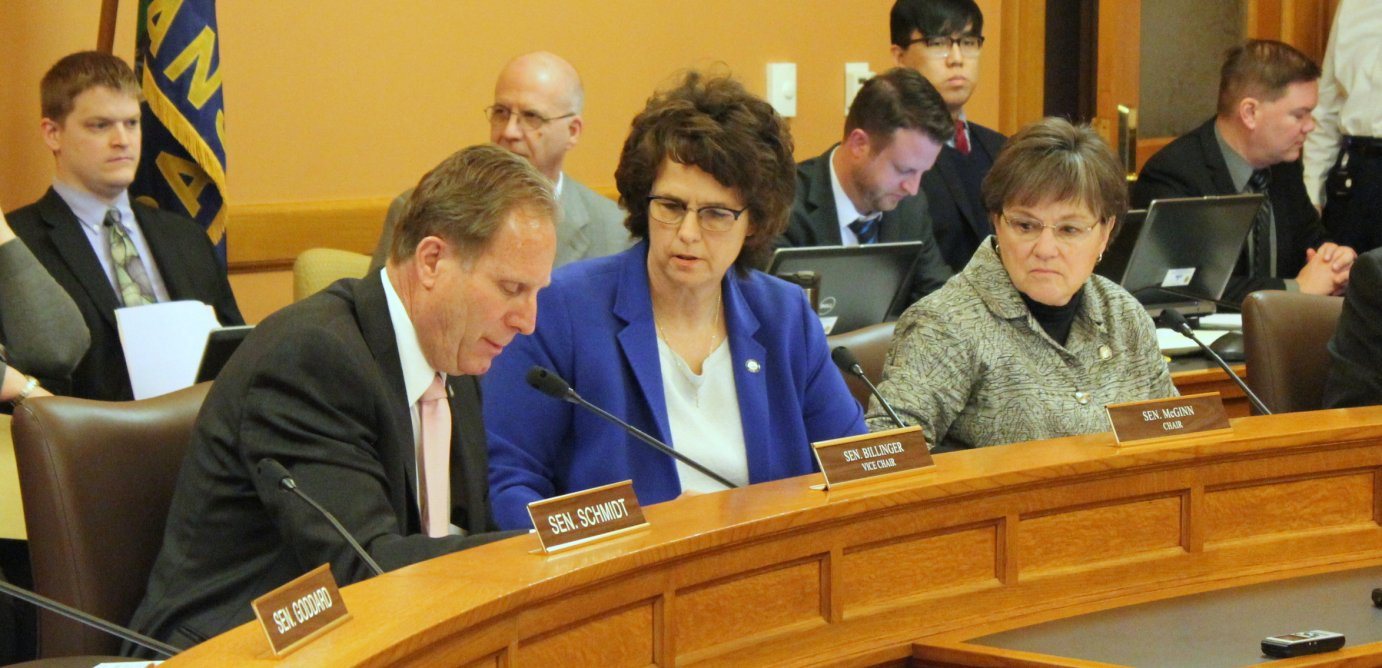 Senators confer during the meeting Tuesday. From left to right are Republican Rick Billinger, Republican Carolyn McGinn and Democrat Laura Kelly. (Photo by Stephen Koranda)