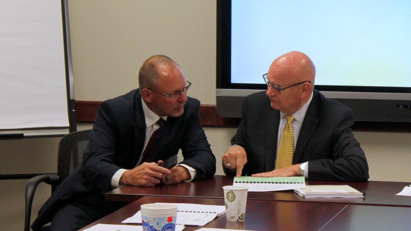 The Kansas Board of Regents voted Wednesday to zero-out tuition increases for in-state undergrads. Vice Chair Shane Bangerter (left) and Chair Dennis Mullin pored over documents before the meeting. (Photo by Stephen Koranda)