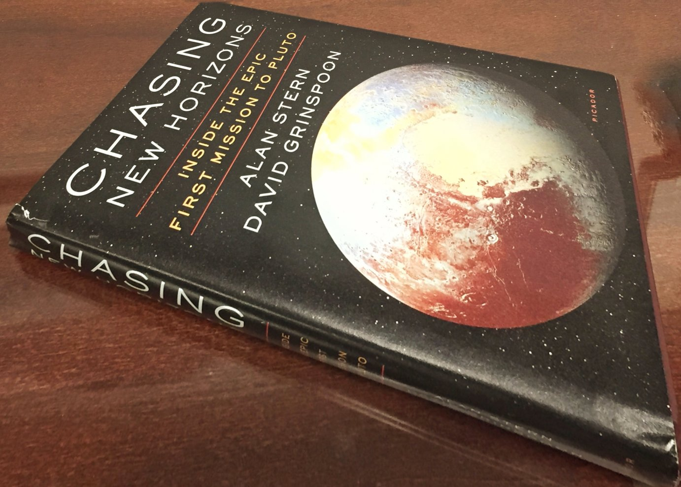 Chasing New Horizons: Inside the Epic First Mission to Pluto, published by Picador USA