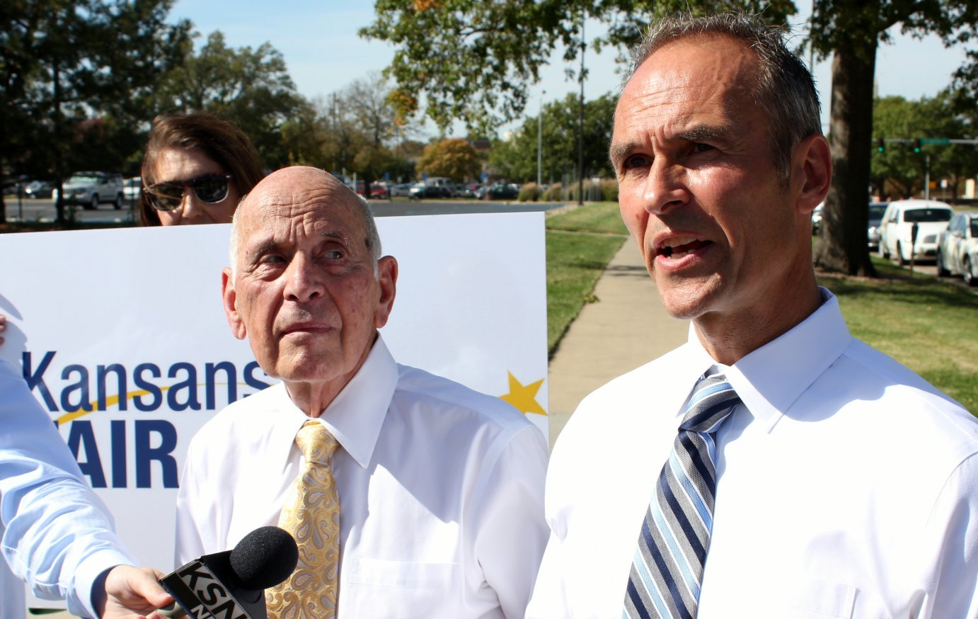 Former AGs Bob Stephan (left) and Steve Six speak to reporters in Topeka. (Photo by Stephen Koranda)