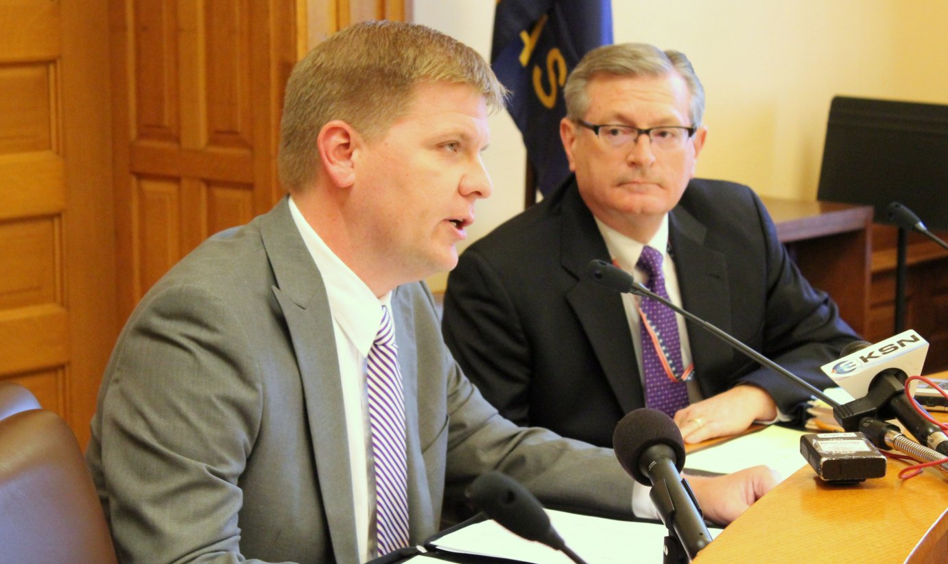 Budget Director Shawn Sullivan (left) speaks about the new revenue projections at the Kansas Statehouse. (Photo by Stephen Koranda)