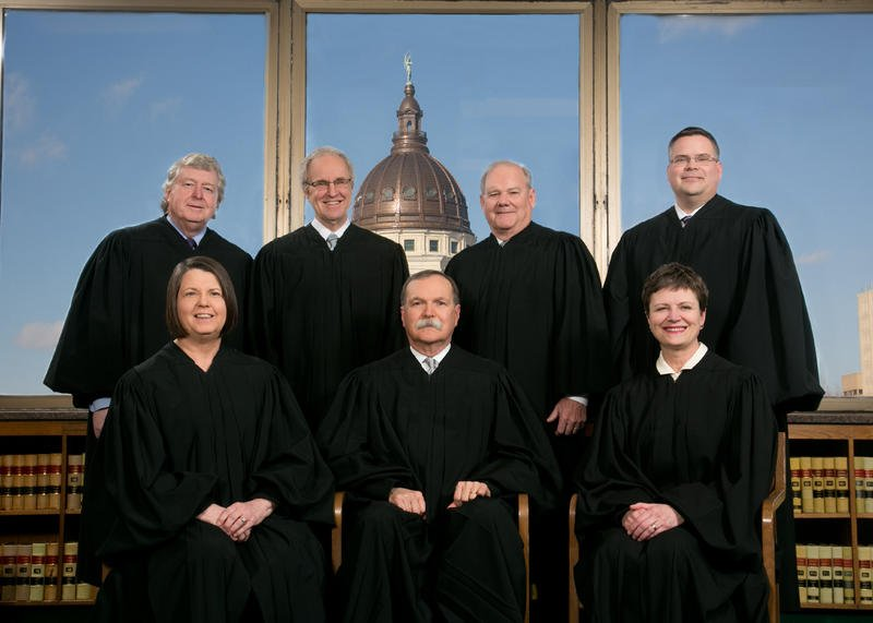 Kansas Supreme Court Justices: Seated left to right are the Honorable Marla J. Luckert, Lawton R. Nuss, Chief Justice and Carol A. Beier. Standing left to right are the Honorable Dan Biles, Eric S. Rosen, Lee A. Johnson and Caleb Stegall.