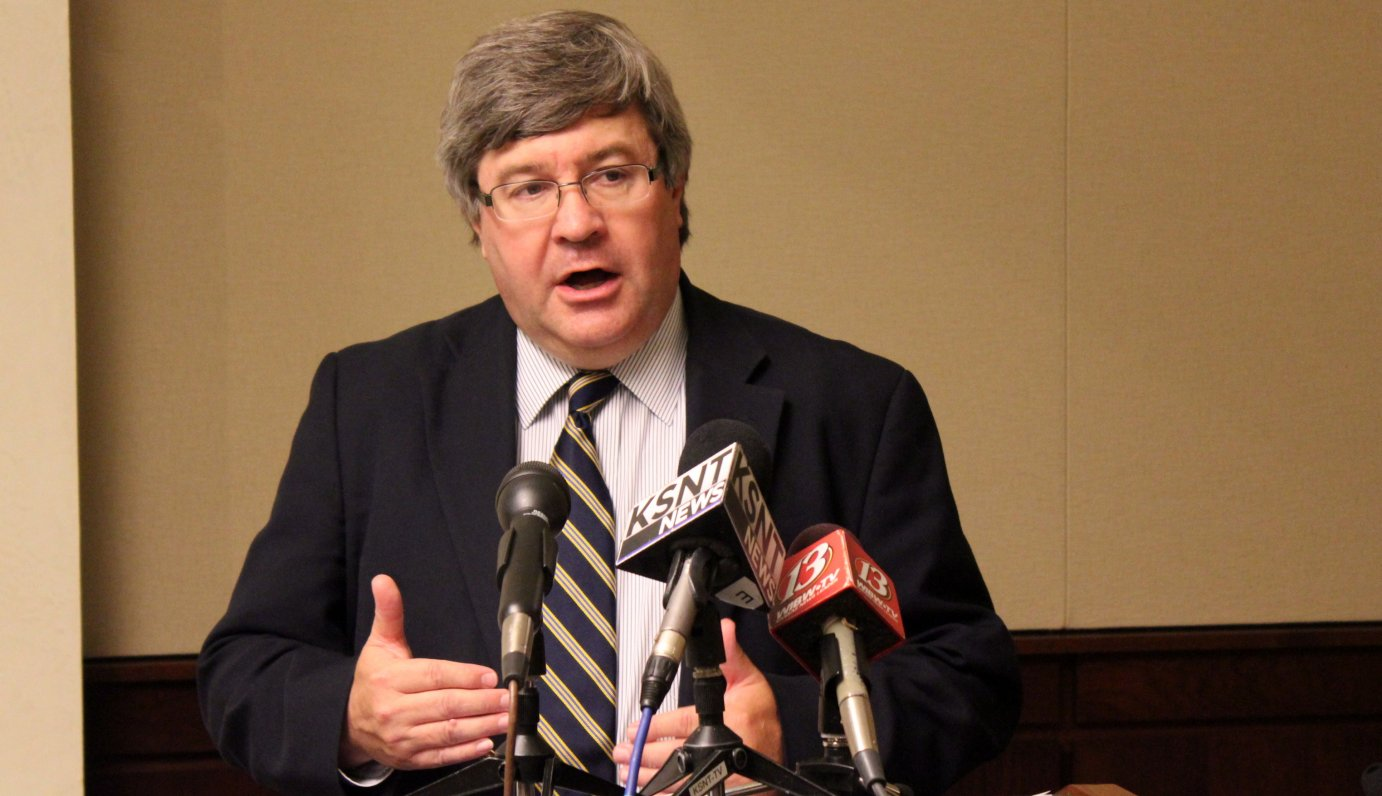 Mark Tallman, with the Kansas Association of School Boards, speaking to reporters. (Photo by Stephen Koranda)