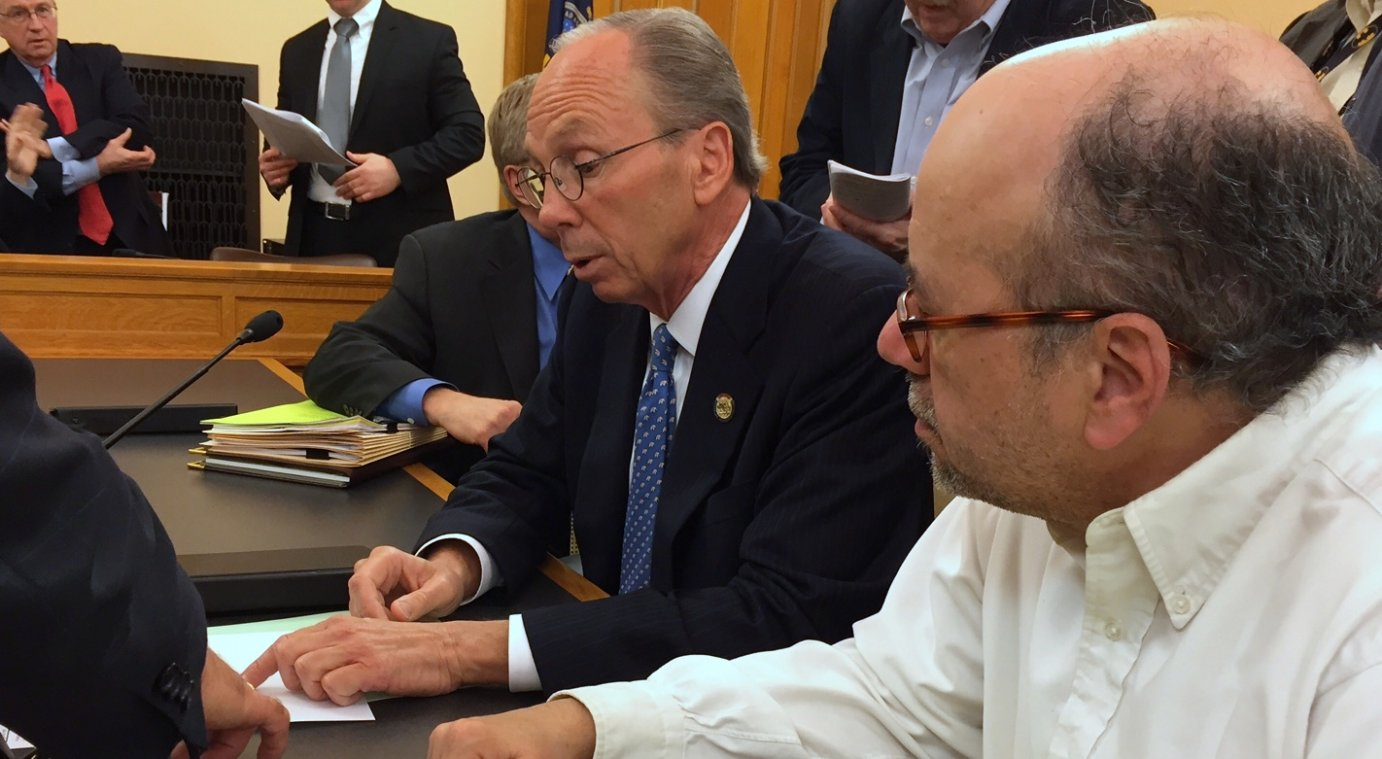 Republican Representative Marvin Kleeb (left) and Democratic Representative Tom Sawyer discuss a tax plan during a committee meeting. (Photo by Stephen Koranda)