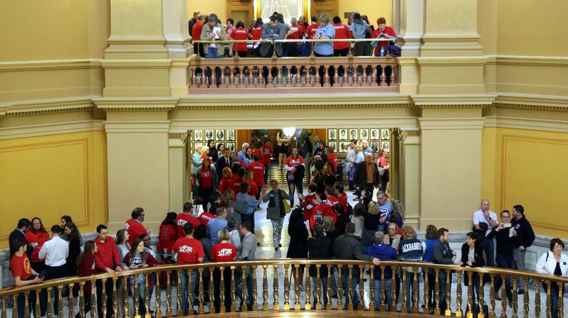 Members of the state's largest teachers union came to the Statehouse Saturday evening to lobby for more school spending.  (Photo by Celia Llopis-Jepsen / Kansas News Service)