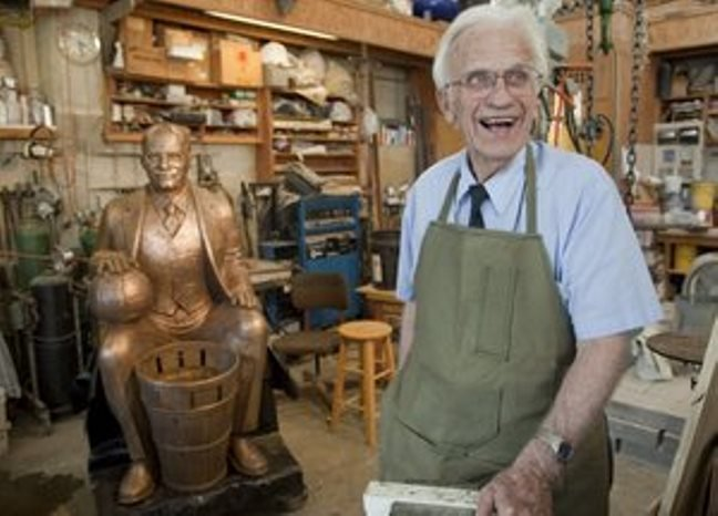 Elden Tefft with his well-known bronze sculpture of James Naismith