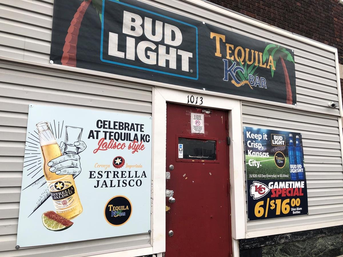 The exterior of Tequila KC, where nine people were shot, four fatally, early Sunday morning. A sign on the bar door specifically says no guns are allowed. (Photo by Elle Moxley / KCUR)