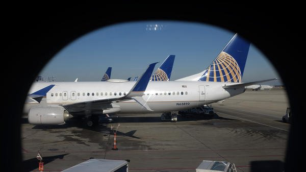 United Airlines planes parked at a terminal at O'Hare International Airport in Chicago. (Photo by Kiichiro Sato / AP)