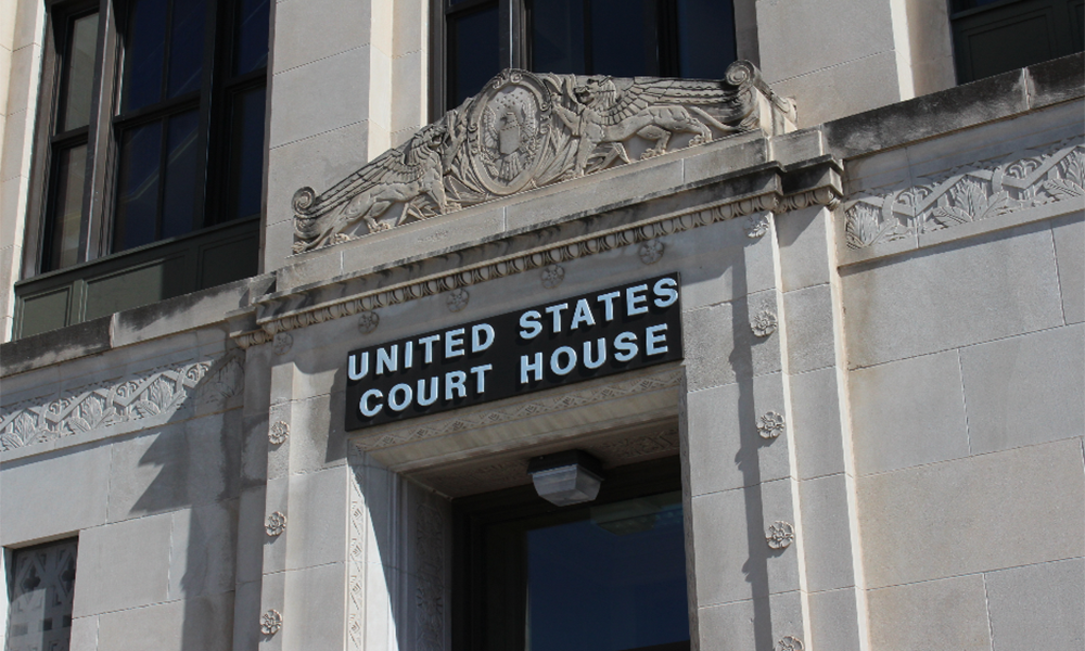 In testimony Wednesday, defense attorneys accused an FBI informant of persuading three men charged in a bombing conspiracy to not abandon the plan. (Photo Credit: Sean Sandefur, KMUW Radio)
