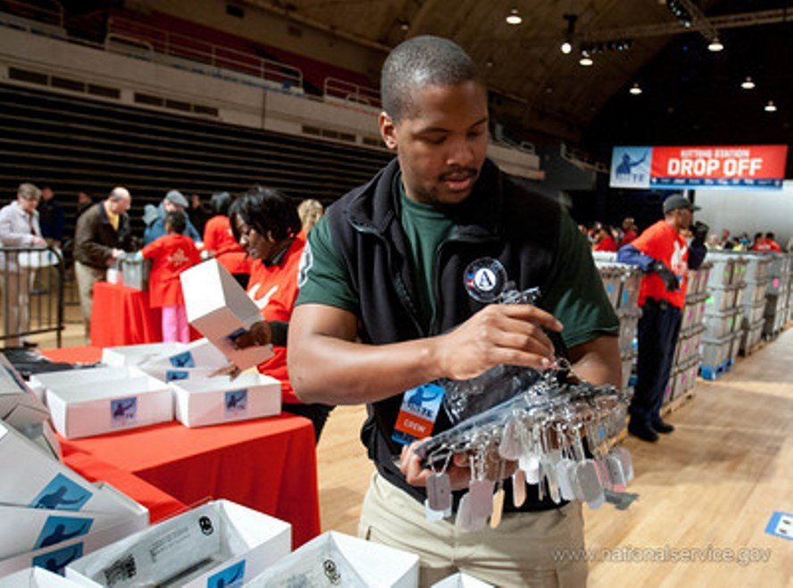 A volunteer packs kits for overseas U.S. troops. (Photo: CNCS)