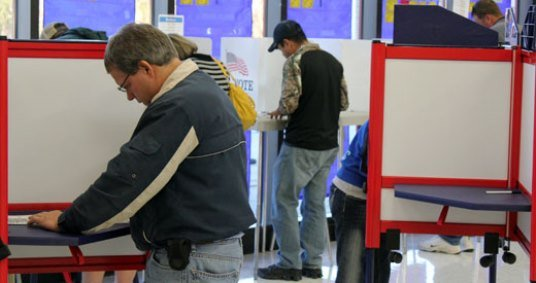 Voters casting ballots in Douglas County in 2012. (Photo by Stephen Koranda)