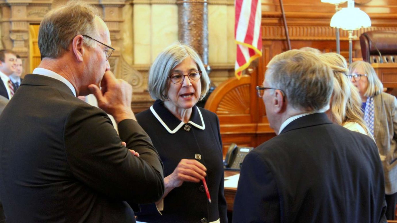 Senate President Susan Wagle, center, talks with Sens. Jeff Longbine, left, and Ed Berger before the chamber rejected Gov. Laura Kelly's nominee for an appellate court. (Photo by Stephen Koranda)