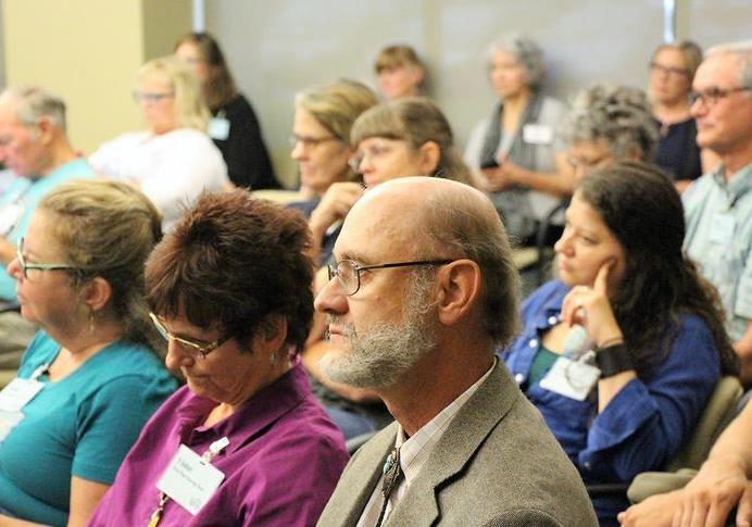 Flint Hills residents hear testimony from James Aber, Emporia State University professor emeritus of geology, seated at front, in their previous effort to block an injection well request. (Photo: Celia Llopis-Jepsen, Kansas News Service)