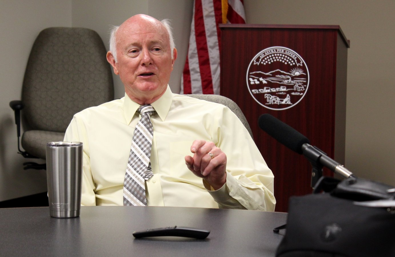 Kansas Department of Revenue Secretary Sam Williams speaking to reporters Friday. (Photo by Stephen Koranda)