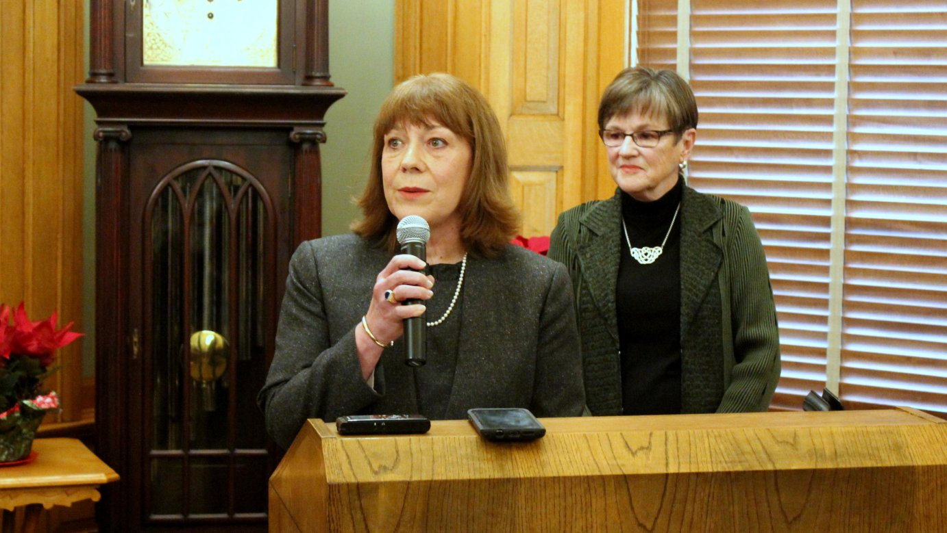 Judge Evelyn Wilson (front) and Gov. Laura Kelly at Monday's announcement. (Photo by Stephen Koranda)
