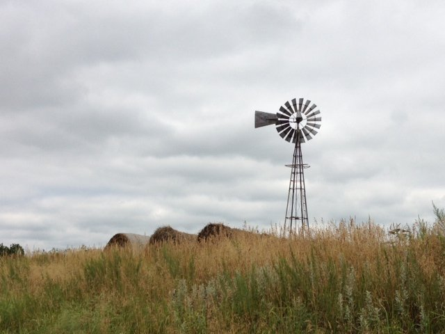 An old windmill stands guard on the high plains of western Kansas. (Photo by J. Schafer)