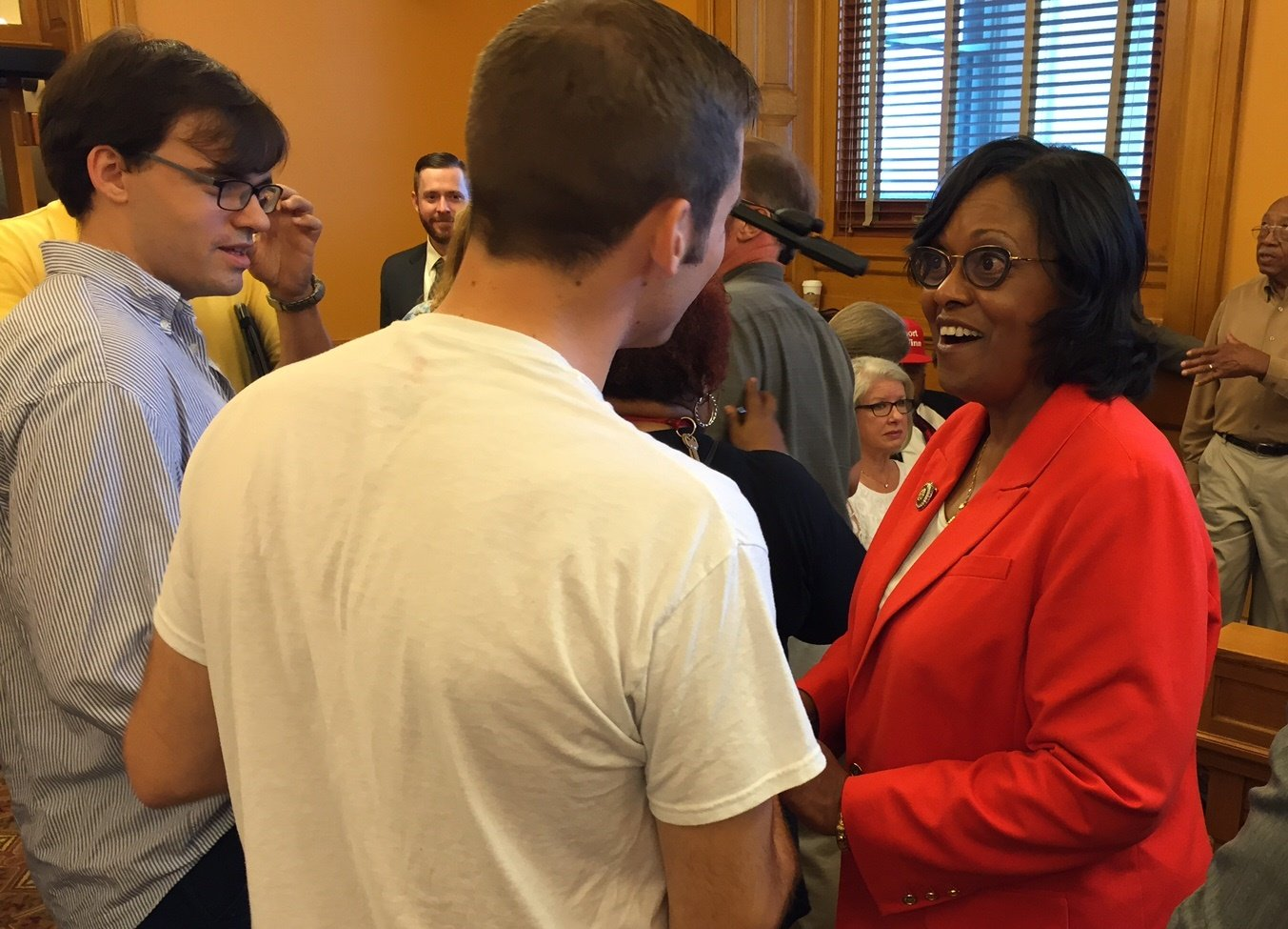 Winn meeting with people who attended the hearing in support of her. (Photo by Stephen Koranda)