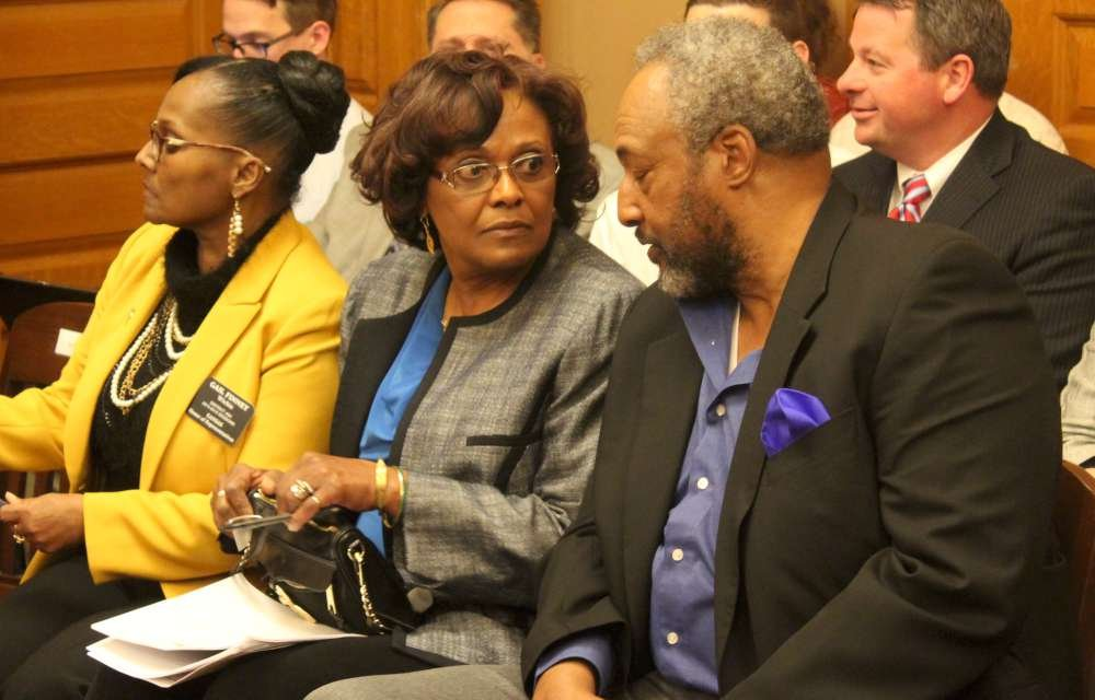 Rep. Winn (center) before the hearing. (Photo by Stephen Koranda)