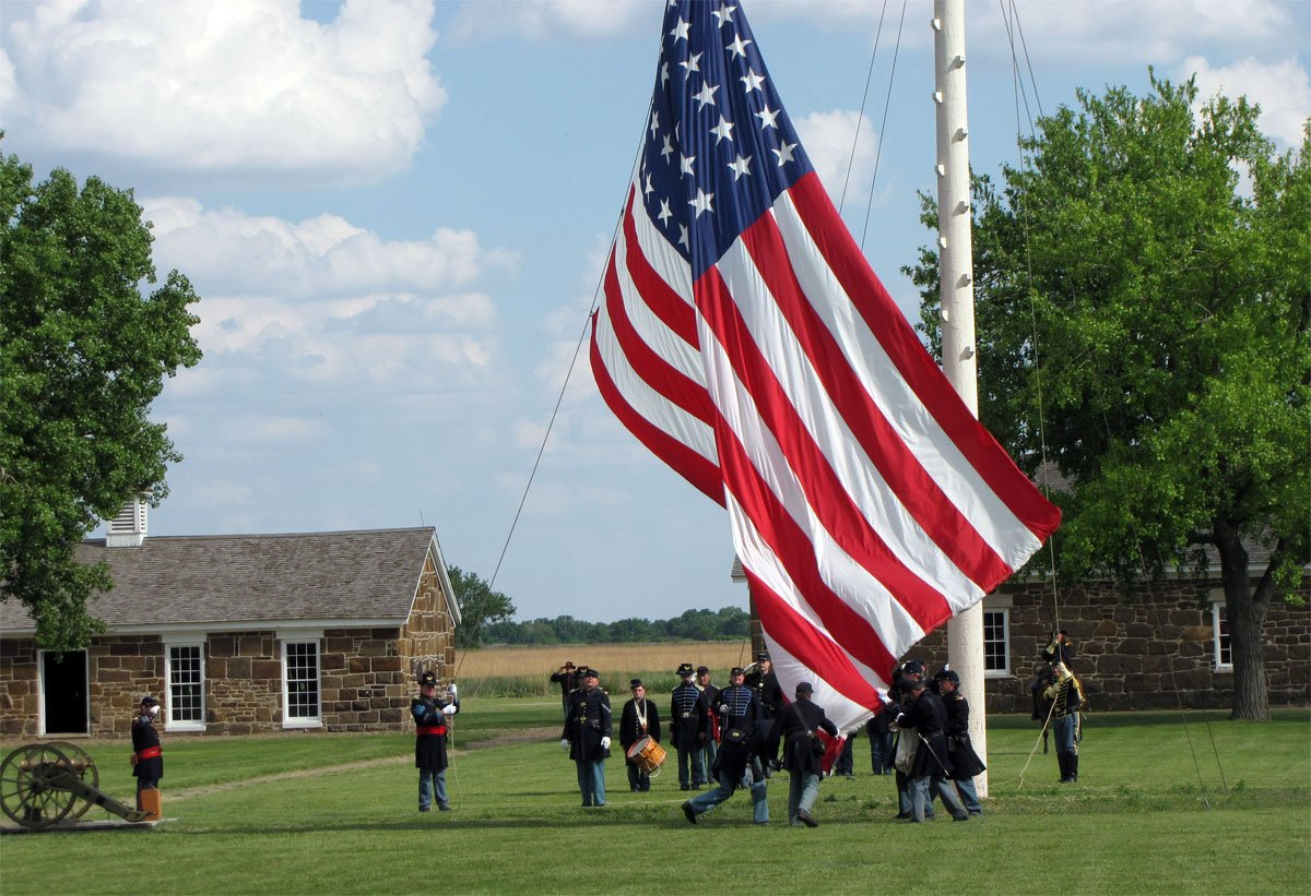 Lowering the large garrison flag at Fort Larned National Historic Site. Taken during Fort Larned's 150th Anniversary on Memorial Day Weekend, 2009. The flag measures 20' by 36'. It is a 37-star flag. (Flickr/KeithWondra)