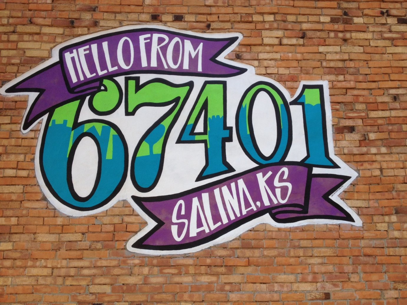 Mural seen on a building in Salina (Photo by Bryan Thompson)