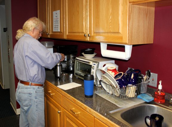 """KPR's Tom Parkinson fixes one of many cups of coffee during his """"Morning Edition"""" shift. (Photo by David Gernon/KPR Intern)"""