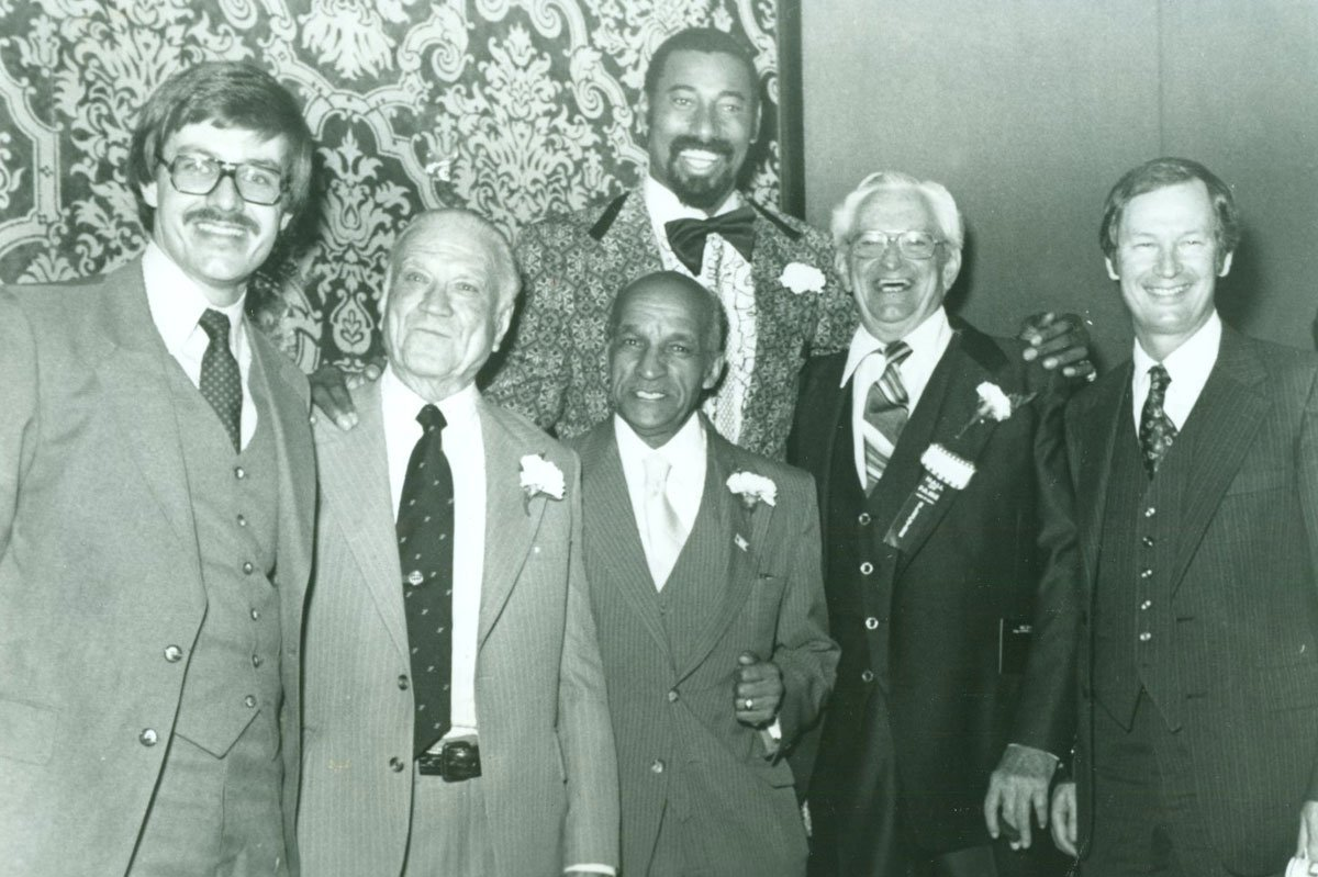 """Wilt Chamberlain with other Hall of Fame inductees, 1979. From left to right: Don Baker, A.C. """"Dutch"""" Lonborg, John McLendon, Wilt Chamberlain, Bill Johnson, and Ted Owens. (Photo Courtesy of Spencer Research Library/KU)"""