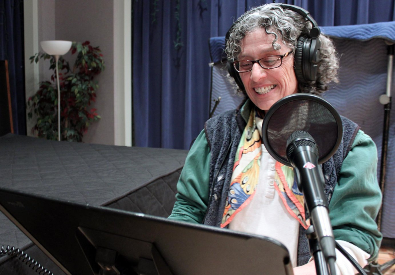 Randi Hacker drops by the KPR studios about every eight weeks to record Postcards from Abroad. (Photo by Joanna Fewins/KPR)