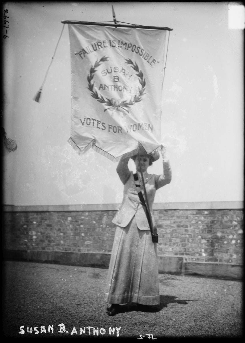 "Photo shows suffragist Florence Jaffray ""Daisy"" Harriman (1870-1967) holding a banner with the words ""Failure Is Impossible. Susan B. Anthony. Votes for Women."" (Source: Flickr Commons project, 2009)"