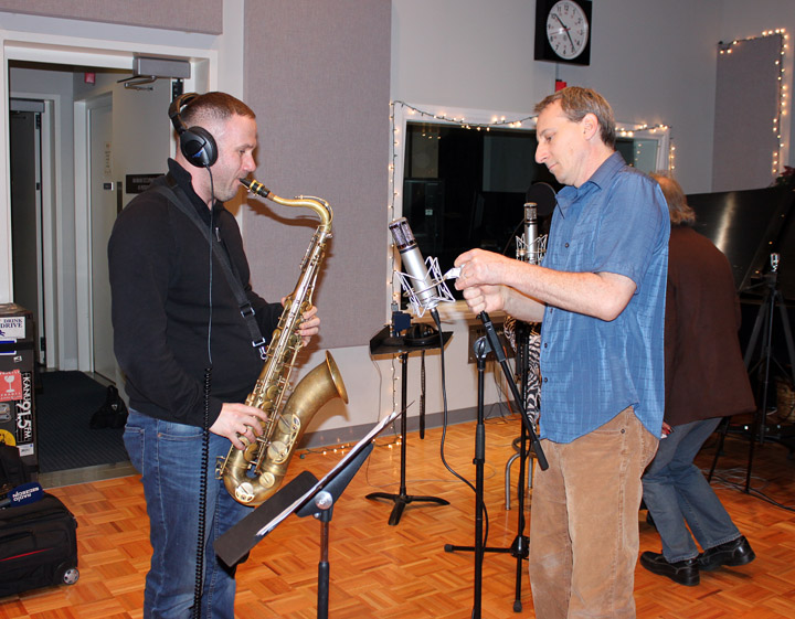 Sylwester Ostrowski practicizes his saxophone while KPR engineer Jason Slote preps for the recording session.