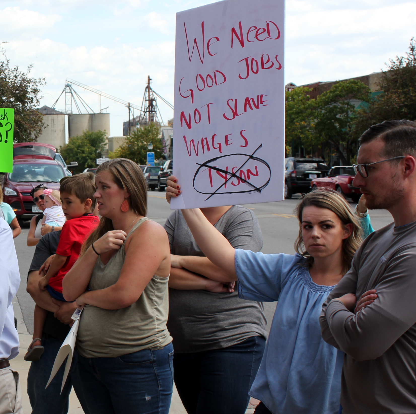 Tana Walker holds a sign during a protest against the project. (Photo by Stephen Koranda)
