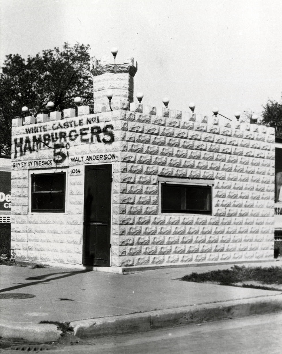 Exterior view of White Castle number 1, located in Wichita, Kansas. White Castle was founded in 1921 by Walt Anderson and Billy Ingram. This was the first White Castle location. White Castle sign reads 5 cent hamburgers. (Photo via Ohio History Connection)