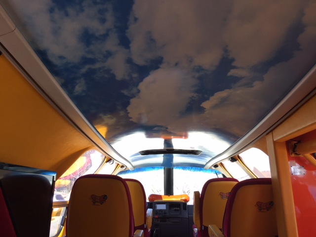 The interior roof of the Wienermobile depicts a beautiful, partly cloudy sky. (Photo by J. Schafer)