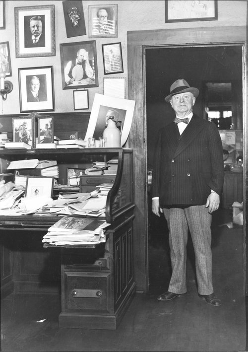 Emporia Gazette editor and publisher William Allen White standing next to his desk in his newspaper office at the Emporia Gazette. (Photos from Kansas Historical Society)
