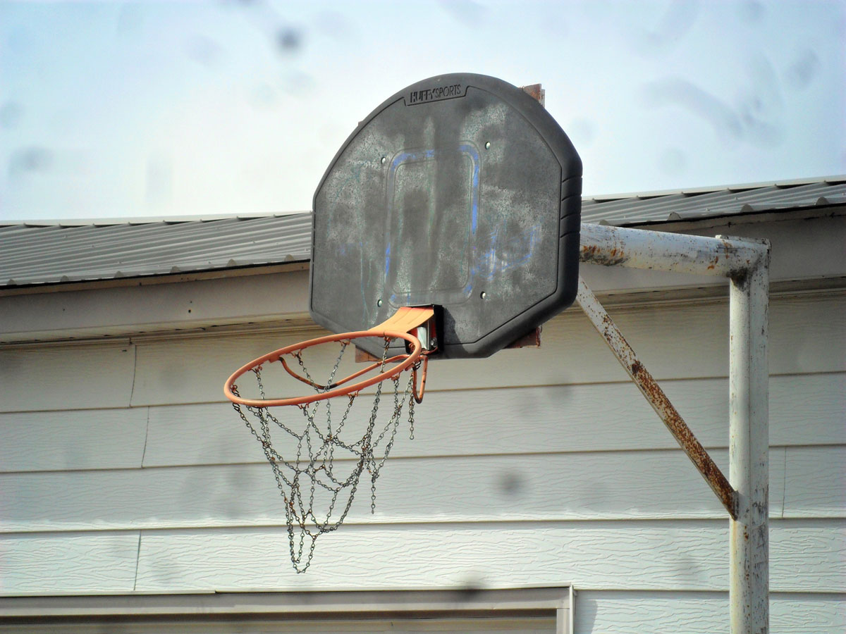 The basketball hoop attached to the garage behind Willie Cauley-Stein's childhood home. (Photo by Greg Echlin)